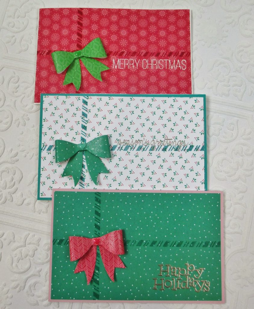 after stamping the striped border directly on the pattern paper i cut out some bows using this die with the adorable pattern papers included in the kit - Christmas Card Money Holder